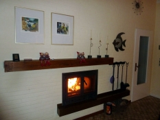 Das Ferienhaus Kolks Huus in Neuharlingersiel an der Nordsee mit geschlossenem Kamin ist ein Bungalow für 4 Personen und 2 Schlafzimmern und überzeugt mit einer lichtdurchfluteten behaglichen Wohnung für offenes Wohnen im Ferienhaus